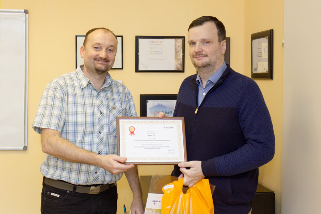 Mr. Vosmik (right) of MARTIA with his first-place prize